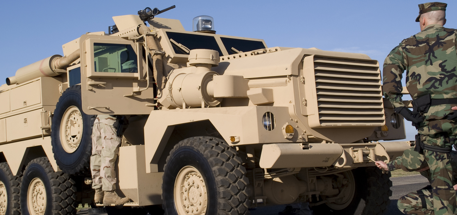 army vehicle and military personnel