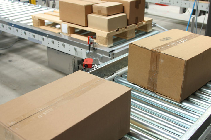 image of boxes on a conveyor belt, warehouse technology installed by St. Onge